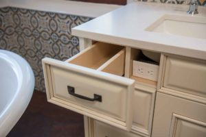 CUSTOM VANITY WITH ELECTRIC RECEPTACLE BEHIND DRAWER FACE