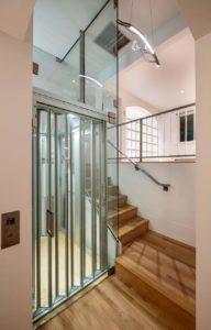 GLASS ELEVATOR ACRYLIC BALLISTERS CUSTOM RAILING